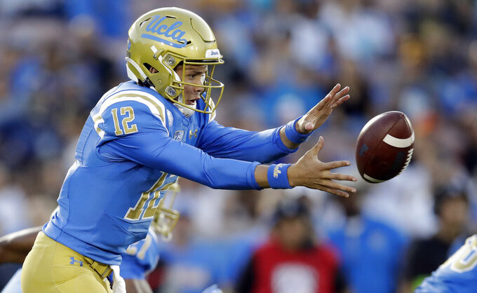 UCLA quarterback Austin Burton takes a snap against Oregon State during the first half of an NCAA college football game Saturday, Oct. 5, 2019, in Pasadena, Calif. (AP Photo/Marcio Jose Sanchez)