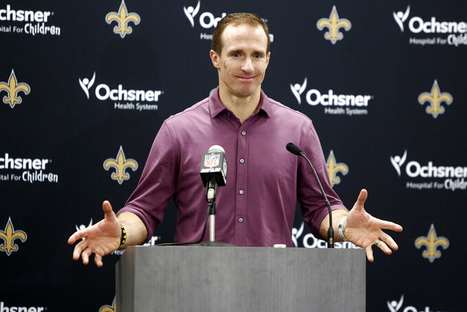 New Orleans Saints quarterback Drew Brees speaks to members of the media following an NFL football game against the Carolina Panthers in Charlotte, N.C., Sunday, Dec. 29, 2019. (AP Photo/Brian Blanco)