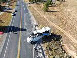 FILE - This Friday, Sept. 20, 2019, photo provided by the Utah Highway Patrol shows a tour bus carrying Chinese-speaking tourists after it crashed near Bryce Canyon National Park in southern Utah, killing at least four people and critically injuring multiple others. The families of Chinese tourists killed or injured in a 2019 tour bus crash say the state's design and maintenance failed to keep the remote highway safe. More than a dozen people were thrown from the bus when the driver drifted off the road and overcorrected when he steered back, sending the bus into a rollover. A lawsuit alleges the state failed to post warning signs, had a road design that left little room for error and included no rumble strip to warn drivers. The Utah Department of Transportation declined to comment. U.S. regulators have previously ruled out highway design, signage and other characteristics as factors. (Utah Highway Patrol via AP, File)