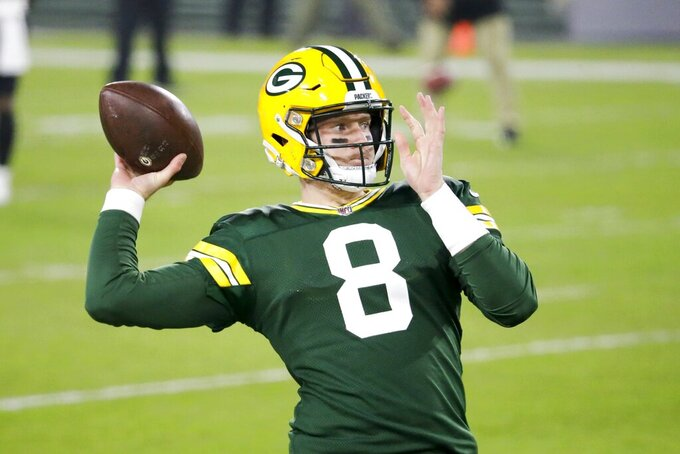 Green Bay Packers' Tim Boyle warms up before an NFL football game against the Carolina Panthers Saturday, Dec. 19, 2020, in Green Bay, Wis. (AP Photo/Mike Roemer)