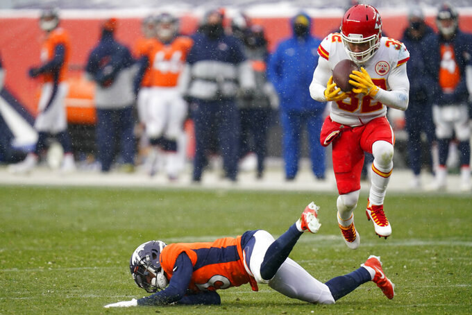 Kansas City Chiefs strong safety Tyrann Mathieu, right, intercepts a pass intended for Denver Broncos wide receiver K.J. Hamler, below, during the second half of an NFL football game Sunday, Oct. 25, 2020, in Denver. (AP Photo/David Zalubowski)