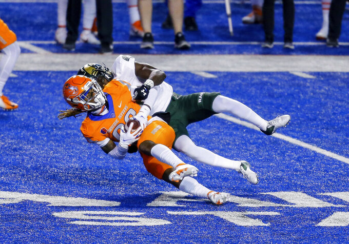 Boise State wide receiver Stefan Cobbs (82) makes a reception against Colorado State during the first half of an NCAA college football game Thursday, Nov. 12, 2020, in Boise, Idaho. (AP Photo/Steve Conner)