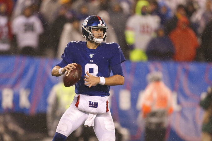 FILE - In this Dec. 29, 2019, file photo, New York Giants quarterback Daniel Jones (8) looks to pass during an NFL football game against the Philadelphia Eagles in East Rutherford, N.J. Jones is facing a much different challenge in his second season with the Giants. The No. 6 pick overall in the 2019 NFL draft is no longer a rookie and he is not at training camp as the understudy and heir apparent to Eli Manning as the Giants' quarterback. Unless something drastic happens, Jones will be the starter when New York kicks off the Joe Judge-era as coach in a Monday night home game against the Pittsburgh Steelers. (AP Photo/Vera Nieuwenhuis, File)