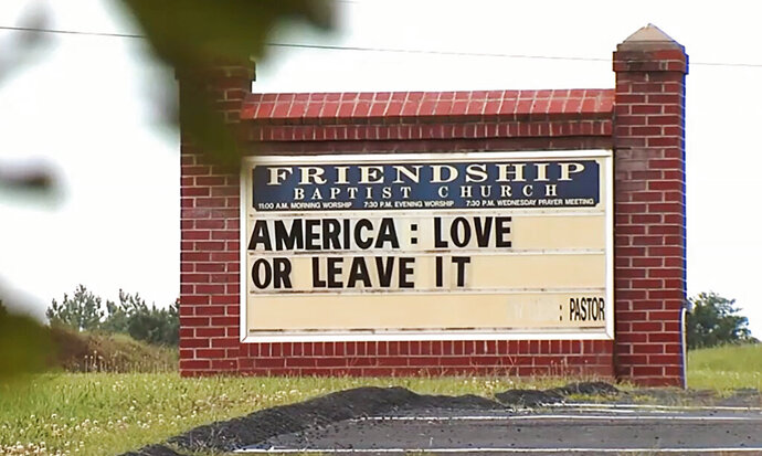 FILE - This Tuesday, July 16, 2019 image from video provided by WSET-TV shows a sign for the Friendship Baptist Church which reads,