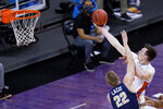 Florida forward Colin Castleton drives to the basket over Oral Roberts forward Francis Lacis (22) during the second half of a college basketball game in the second round of the NCAA tournament at Indiana Farmers Coliseum, Sunday, March 21, 2021 in Indianapolis. (AP Photo/AJ Mast)