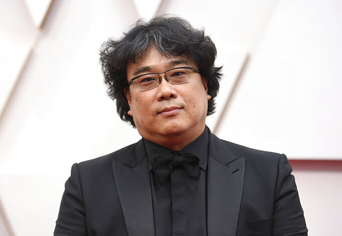 """FILE - Bong Joon-ho arrives at the Oscars on Sunday, Feb. 9, 2020, in Los Angeles. The """"Parasite"""" director has been selected as jury president of the 78th Venice International Film Festival, organizers said Friday. The Oscar-winner will preside over seven jurors to hand out the festival's top awards, including the prestigious Golden Lion. (Photo by Richard Shotwell/Invision/AP, File)"""