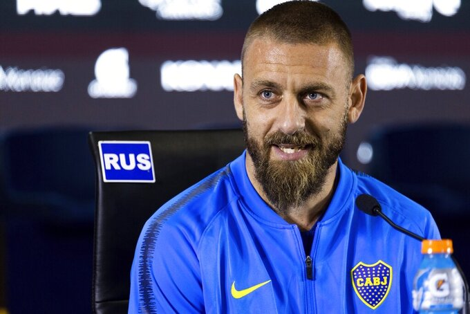 FILE - In this Monday, July 29, 2019 file photo, Daniele De Rossi speaks during a press conference in Buenos Aires, Argentina. The Italian soccer federation said Friday, April 9, 2021 that Italy assistant coach De Rossi had been admitted to an infectious diseases hospital with pneumonia after testing positive for the coronavirus. He was one of four Azzurri staff members to contract COVID-19 during recent World Cup qualifiers. (AP Photo/Tomas F. Cuesta, File)