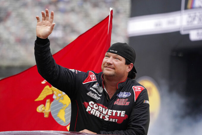 BJ McLeod waves to fans before a NASCAR Cup Series auto race at Bristol Motor Speedway Saturday, Sept. 18, 2021, in Bristol, Tenn. (AP Photo/Mark Humphrey)
