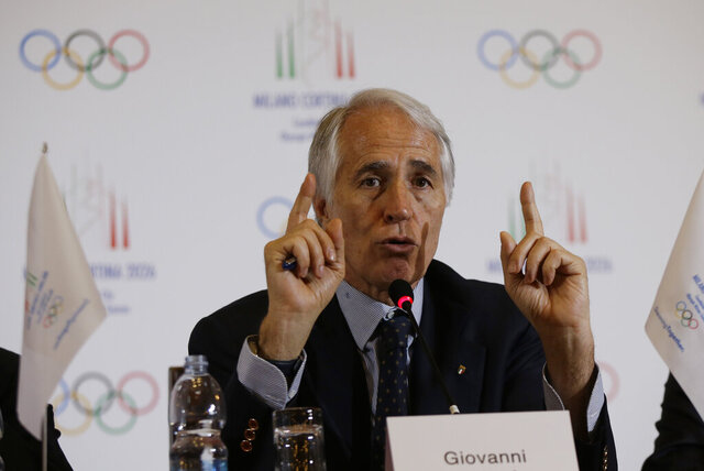 FILE - In this April 6, 2019 file photo, President of the Italian National Olympic Committee, CONI, Giovanni Malago' gestures as he talks during a winter Olympics Milan Cortina bid IOC Evaluation Commission final news conference, in Milan, Italy. The International Olympic Committee is slated in January 2021 to consider imposing a humiliating probation on Italy's team for the Tokyo Games due to a two-year domestic dispute that it says amounts to government interference. (AP Photo/Luca Bruno, file)