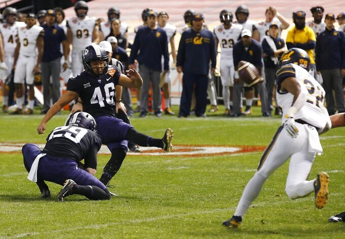 FILE - In this Dec. 26, 2018, file photo, TCU place-kicker Jonathan Song (46) connects for the game-winning field goal from the hold of Adam Nunez (29) as California's Traveon Beck (22) tries in vain to reach the ball during overtime of the Cheez-It Bowl NCAA college football game, in Phoenix. Song was selected to The Associated Press All-Big 12 Conference team, Friday, Dec. 13, 2019.  (AP Photo/Ross D. Franklin, File)
