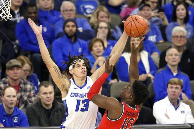 Creighton's Christian Bishop (13) blocks a shot by St. John's Marcellus Earlington (10) during the first half of an NCAA college basketball game in Omaha, Neb., Saturday, Feb. 8, 2020. (AP Photo/Nati Harnik)