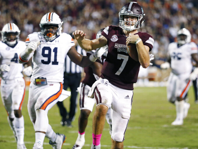 Mississippi State quarterback Nick Fitzgerald (7) leaps into the end zone with a touchdown during the second half of an NCAA college football game against Auburn in Starkville, Miss., Saturday, Oct. 6, 2018. Mississippi State won 23-9. (AP Photo/Rogelio V. Solis)