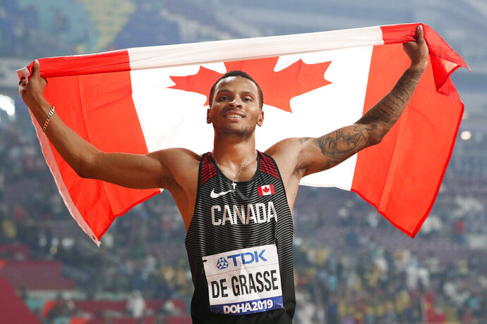 FILE - In this Oct. 1, 2019, file photo, Andre de Grasse, of Canada, celebrates after winning the silver medal in the men's 200 meters at the World Athletics Championships in Doha, Qatar. When the American Track League opens its four-week-long series on Sunday, Jan. 24, 2021 de Grasse will be one of the athletes competing at the indoor setting at the University of Arkansas. (AP Photo/Hassan Ammar, File)