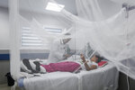 In this photo taken on Sept. 5, 2019, a patient receives treatment for dengue inside a room at the Fernando Velez Hospital in Managua, Nicaragua. As a region, Central America and Mexico have already recorded nearly double the number of dengue cases as in all the previous year. Guatemala, Mexico and Nicaragua have seen double-digit death tolls. (AP Photo/Alfredo Zuniga)
