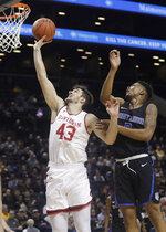 Davidson's Dusan Kovacevic (43) drives past Saint Louis' Jordan Goodwin (0) during the first half of an NCAA college basketball game in the semifinal round of the Atlantic 10 men's tournament Saturday, March 16, 2019, in New York. (AP Photo/Frank Franklin II)