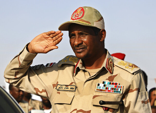 FILE - In this June 15, 2019 file photo, Gen. Mohammed Hamdan Dagalo, the deputy head of the military council, salutes during a rally, in Galawee, northern Sudan. Sudan's transitional authorities and a rebel faction reached a peace deal, part of government efforts to end the country's decadeslong civil wars. The government said it signed the deal Tuesday, Dec. 24, 2019, with a faction of the Sudan Revolutionary Front in South Sudan's capital, Juba. The deal could pave the way for other peace agreements with more factions, as well as other rebel groups. (AP Photo, File)