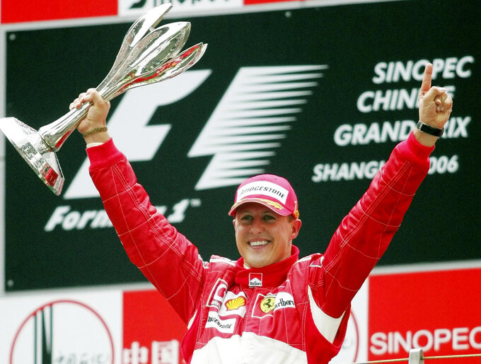 FILE - In this Oct. 1, 2006 file photo, Germany's Michael Schumacher celebrating winning the Formula One Chinese Grand Prix auto race at the Shanghai International Circuit in Shanghai, China. Schumacher's family, in a statement Wednesday, Jan. 2, 2019, has asked for understanding as it continues to keep details of his health private ahead of the seven-time Formula One champion's 50th birthday. Schumacher suffered serious head injuries in an accident while he was skiing with his teenage son Mick in the French Alps at Meribel on Dec. 29, 2013. (AP Photo/Greg Baker, File)