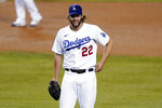 Los Angeles Dodgers starting pitcher Clayton Kershaw smiles during the eighth inning in Game 2 of the team's National League wild-card baseball series against the Milwaukee Brewers on Thursday, Oct. 1, 2020, in Los Angeles. (AP Photo/Ashley Landis)