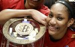South Carolina forward A'ja Wilson celebrates with the team's trophy after defeating Mississippi State in the NCAA college basketball championship game at the women's Southeastern Conference tournament, Sunday, March 4, 2018, in Nashville, Tenn. (AP Photo/Mark Humphrey)