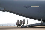 In this photo provided by the U.S. Marine Corps, U.S. Marines and sailors carry a casket aboard a U.S. Air Force C-17 Globemaster III at Marine Corps Air Station Miramar, in Calif., Wednesday, Aug. 12, 2020. The remains of seven Marines and a sailor, who died after a seafaring tank sank off the coast of Southern California last month, were transferred to Dover Air Force Base in Delaware for burial preparations.  (Staff Sgt. Kassie McDole/U.S. Marine Corps via AP)