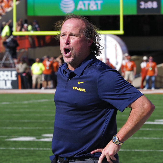 West Virginia head coach Dana Holgorsen shows his emotion after his team was penalized during the first half of an NCAA college football game against Texas, Saturday, Nov. 3, 2018, in Austin, Texas. (AP Photo/Michael Thomas)