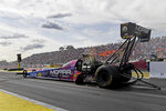In this photo provided by the NHRA, Top Fuel's Leah Pritchett competes in the Lucas Oil NHRA Nationals at Brainerd International Raceway in Brainerd, Minn., Sunday, Aug. 18, 2019. Pritchett won over Mike Salinas in the final round at the raceway with her 3.732 second run at 321.04 mph to conclude the 38th annual Lucas Oil NHRA Nationals. (Marc Gewertz/NHRA via AP)