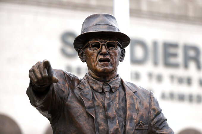 The newly dedicated statue of Chicago Bears founder George S. Halas stands outside Soldier Field during a unveiling ceremony of statues honoring Halas and Walter Payton Tuesday, Sept. 3, 2019, in Chicago. (AP Photo/Charles Rex Arbogast)