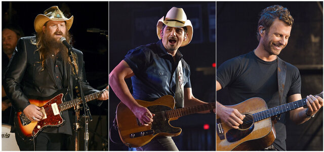 This combination photo shows country music stars, from left, Chris Stapleton, Brad Paisley and Dierks Bentley performing in concert. The multibillion-dollar concert industry halted after the outbreak of novel coronavirus in the United States. Now thousands of small businesses and contract workers who live gig to gig are facing an uncertain future. (AP Photo)