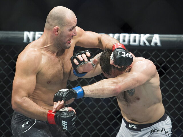 FILE - In this Sept. 14, 2019, file photo, Glover Teixeira, left, fights Nikita Krylov during their light heavyweight match at UFC Fight Night in Vancouver, British Columbia. Teixeira dominated Anthony Smith and finally stopped him with punches early in the fifth round Wednesday night, May 13, 2020, earning an upset victory to cap the UFC's second show since returning to action amid the coronavirus pandemic. (Jonathan Hayward/The Canadian Press via AP, File)