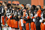 The Cleveland Browns line up arm-in-arm before an NFL football game against the Cincinnati Bengals, Thursday, Sept. 17, 2020, in Cleveland. (AP Photo/Ron Schwane)