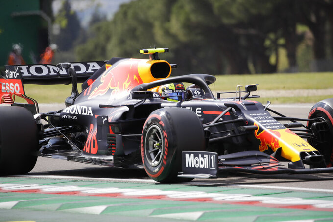 Red Bull driver Sergio Perez of Mexico steers his car during qualifying practice for Sunday's Emilia Romagna Formula One Grand Prix, at the Imola track, Italy, Saturday, April 17, 2021. (AP Photo/Luca Bruno)