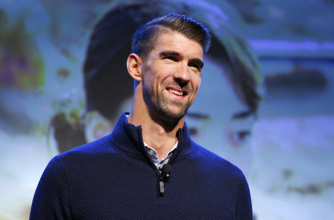 Emotions stir Michael Phelps in his return to US trials