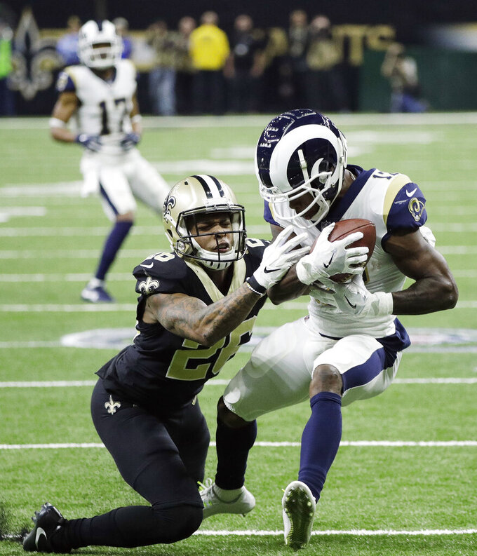 Los Angeles Rams' Brandin Cooks catches a pass in front of New Orleans Saints' P.J. Williams during the first half the NFL football NFC championship game, Sunday, Jan. 20, 2019, in New Orleans. (AP Photo/David J. Phillip)