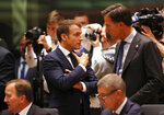 French President Emmanuel Macron, left, speaks with Dutch Prime Minister Mark Rutte during a round table meeting at an EU summit in Brussels, Thursday, Oct. 17, 2019. Britain and the European Union reached a new tentative Brexit deal on Thursday, hoping to finally escape the acrimony, divisions and frustration of their three-year divorce battle. (AP Photo/Frank Augstein)
