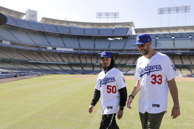 New Los Angeles Dodgers players David Price, right, and Mookie Betts walk after a news conference to announce their acquisition at Dodger Stadium in Los Angeles, Wednesday, Feb. 12, 2020. (AP Photo/Chris Carlson)