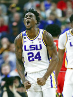 LSU's Emmitt Williams (24) celebrates after making a shot against Maryland during the first half of a second-round game in the NCAA men's college basketball tournament in Jacksonville, Fla., Saturday, March 23, 2019. (AP Photo/John Raoux)