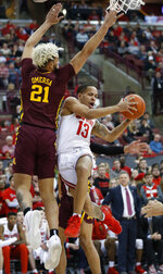 Ohio State's C.J. Walker, right, tries to shoot over Minnesota's Jarvis Omersa during the second half of an NCAA college basketball game Thursday, Jan. 23, 2020, in Columbus, Ohio.  (AP Photo/Jay LaPrete)