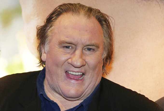 "FILE - In this Monday, Nov. 14, 2016 file photo, actor Gerard Depardieu attends the premiere of the movie ""Tour de France"", in Paris.  The Paris prosecutor's office said Tuesday Feb. 23, 2021, commenting on charges after they were leaked to the French press, saying that French actor Gerard Depardieu was handed preliminary rape and sexual assault charges on Dec. 16, 2020, without the actor being detained. (AP Photo/Thibault Camus, File)"