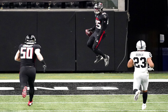 Atlanta Falcons linebacker Deion Jones (45) celebrates a touchdown after an interception against the Las Vegas Raiders during the second half of an NFL football game, Sunday, Nov. 29, 2020, in Atlanta. (AP Photo/John Bazemore)