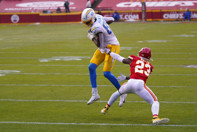 Los Angeles Chargers tight end Donald Parham Jr. catches an 8-yard touchdown pass in front of Kansas City Chiefs safety Armani Watts (23) during the first half of an NFL football game, Sunday, Jan. 3, 2021, in Kansas City. (AP Photo/Jeff Roberson)
