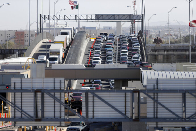 FILE - In this March 29, 2019 file photo, cars and trucks line up to enter the U.S. from Mexico at a border crossing in El Paso, Texas. A 2½-year-old Guatemalan child has died after crossing the border, becoming the fourth minor known to have died after being detained by the Border Patrol since December and raising new alarms about the treatment of migrant families seeking asylum in the United States. (AP Photo/Gerald Herbert, File)