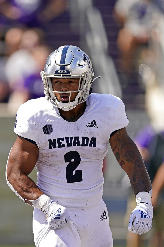 Nevada running back Devonte Lee celebrates after scoring a touchdown during the first half of an NCAA college football game against Kansas State Saturday, Sept. 18, 2021, in Manhattan, Kan. (AP Photo/Charlie Riedel)