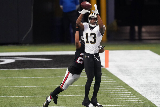 New Orleans Saints wide receiver Michael Thomas (13) makes the catch ahead pf Atlanta Falcons strong safety Keanu Neal (22) during the first half of an NFL football game, Sunday, Dec. 6, 2020, in Atlanta. (AP Photo/John Bazemore)
