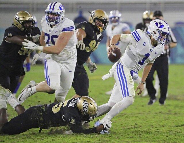 UCF linebacker Tatum Bethune (15) sacks BYU quarterback Zach Wilson (1) in the fourth quarter in the Boca Raton Bowl NCAA college football game at FAU Stadium in Boca Raton, Fla. Tuesday, Dec. 22, 2020.(Al Diaz/Miami Herald via AP)