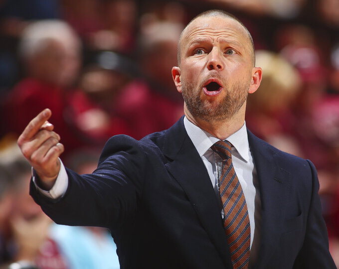 Winthrop head coach Pat Kelsey yells instructions to his team in the second half of an NCAA college basketball game against Florida State in Tallahassee, Fla., Tuesday, Jan. 1, 2019. Florida State won 87-76. (AP Photo/Phil Sears)