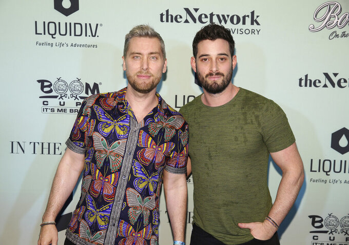 Singer Lance Bass and husband Michael Turchin attend the Bootsy On the Water at the Miami Seaquarium on Friday, Jan. 31,2020, in Miami, FL. (Photo by Donald Traill/Invision/AP)