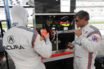Dane Cameron, left, prepares to go out on the track after Juan Pablo Montoya, right, comes in for a break during testing for the upcoming Rolex 24 hour auto race at Daytona International Speedway, Friday, Jan. 3, 2020, in Daytona Beach, Fla. (AP Photo/John Raoux)