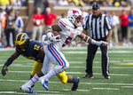 SMU running back Xavier Jones (5) avoids a tackle attempt from Michigan linebacker Josh Ross (12) while rushing in the first quarter of an NCAA college football game in Ann Arbor, Mich., Saturday, Sept. 15, 2018. (AP Photo/Tony Ding)