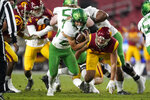 Oregon running back Travis Dye (26) runs the ball during the first quarter of an NCAA college football game for the Pac-12 Conference championship against Southern California Friday, Dec 18, 2020, in Los Angeles. (AP Photo/Ashley Landis)