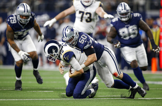 "FILE - Dallas Cowboys outside linebacker Sean Lee (50) sacks Los Angeles Rams quarterback Jared Goff (16) during an NFL football game in Arlington, Texas, in this Sunday, Dec. 15, 2019, file photo. Sean Lee retired Monday, April 26, 2021, after the linebacker spent all of his 11 mostly injury-plagued seasons with the Dallas Cowboys. The 34-year-old said in a letter released by the club that it was ""my time to walk away."" (AP Photo/Brandon Wade, File)"